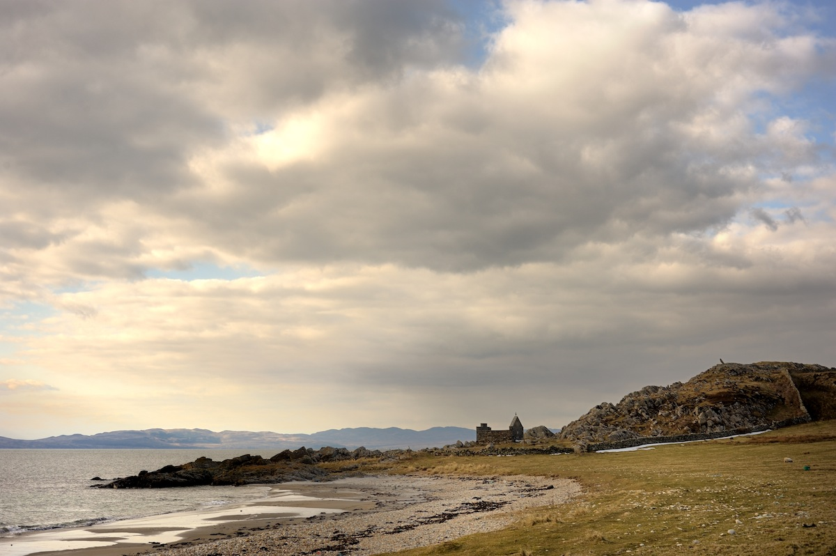 along-shore-beach-rocks-cloudy-sky.jpg
