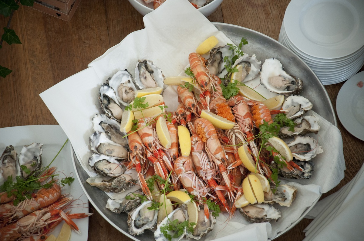 close-up-fish-course-mussels-shrimp-lemon-dips-guests-buffet.jpg